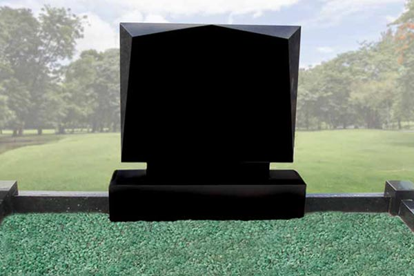 Black headstone with green glass chippings