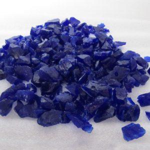 Dark Ink blue recycled glass chippings on white background