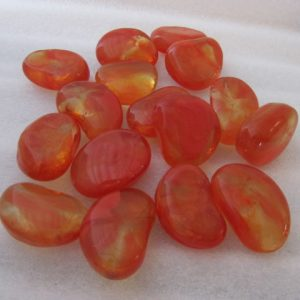 Collection of orange glass pebbles from Midland Stone
