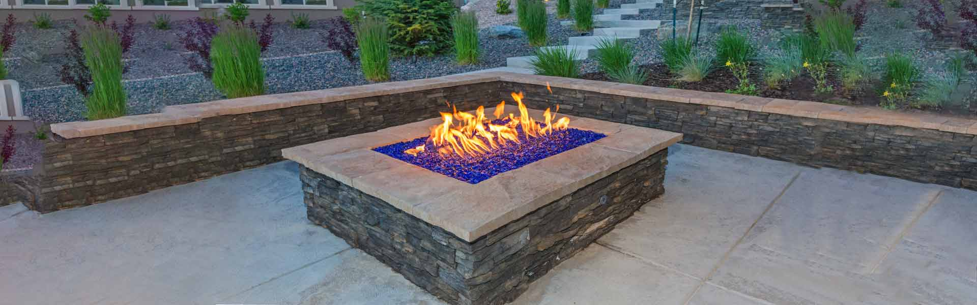 Stunning blue glass chippings in outdoor garden fire pit.