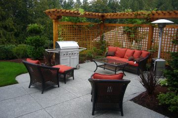 Paving slabs outdoor area with garden furniture and BBQ