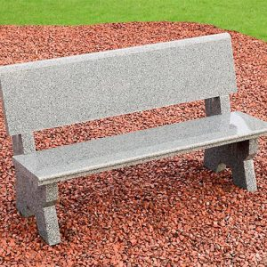 Grey Granite garden bench sitting on red stone chippings