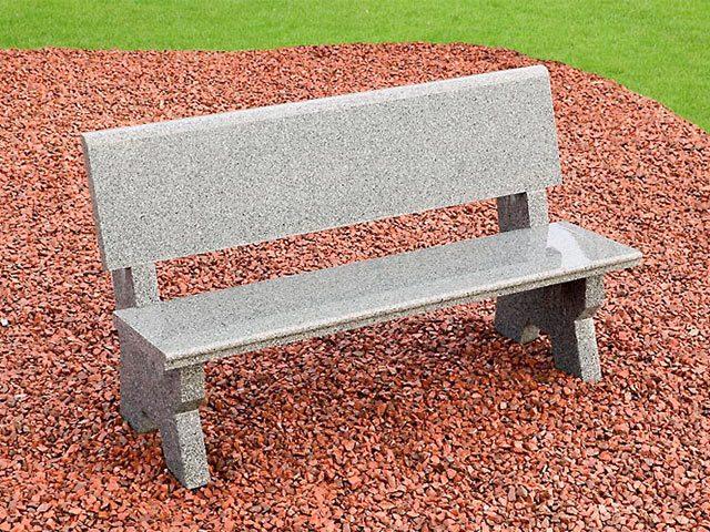 Grey Granite garden bench sitting on red stone chippings