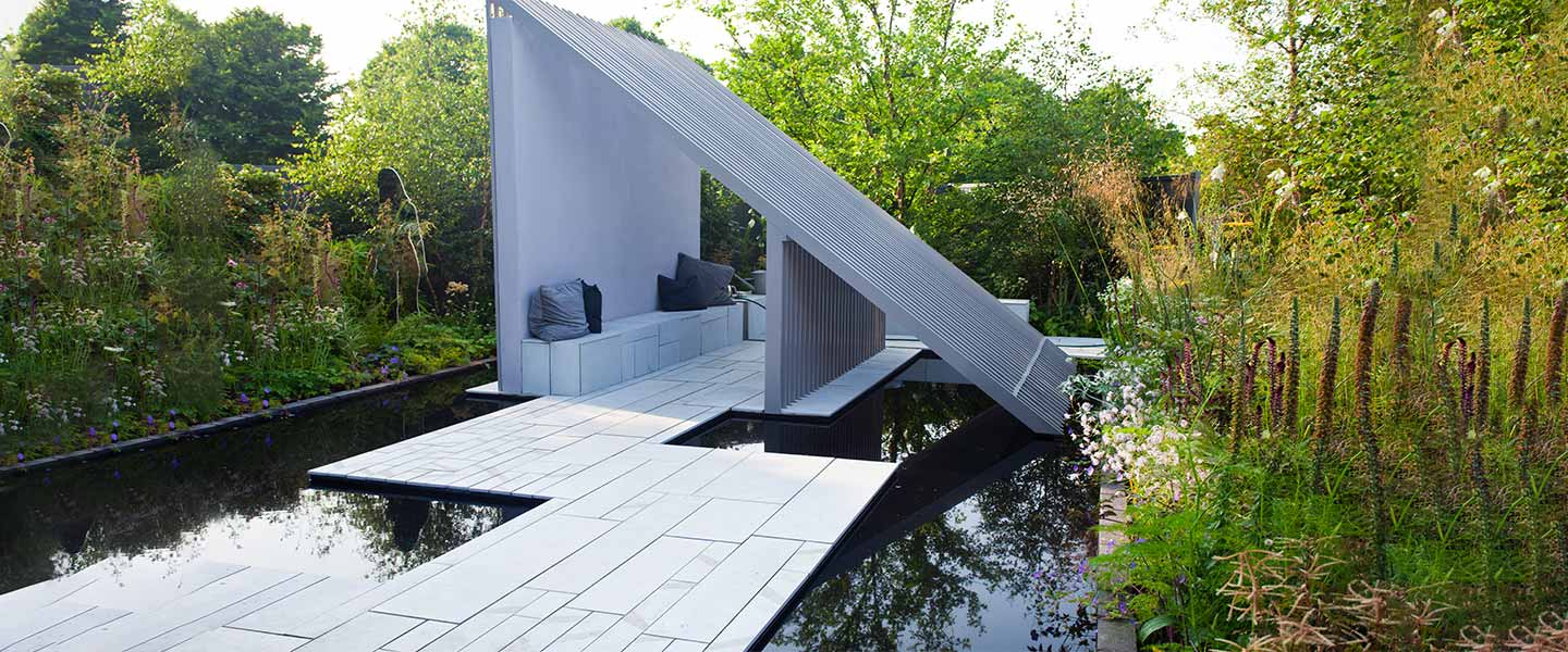 Title Contemporary designer garden with Grey sandstone paving slabs