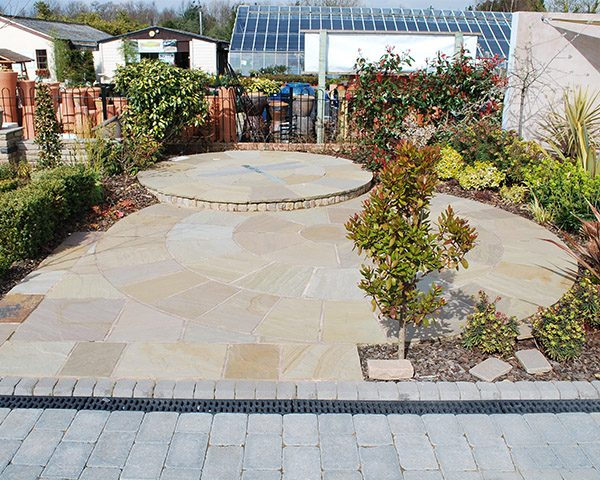 Mint Indian Sandstone with a second tier surrounded with beautiful plants and pots