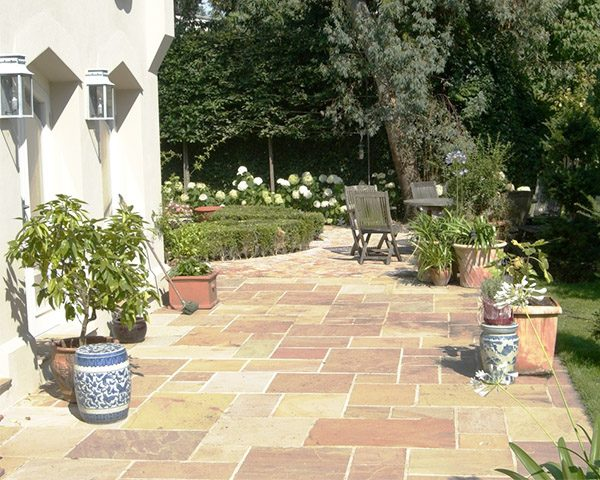 Camel Dust Indian Sandstone Natural Paving Stone in back garden and surrounding the house
