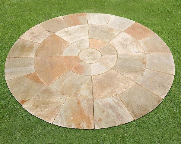 An island of Mint Circle Paving Stone surrounded by grass
