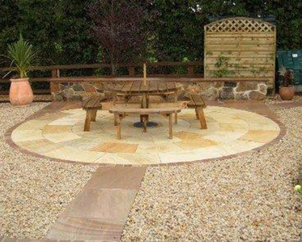 Mint Circle Paving Stone with wooden garden furniture