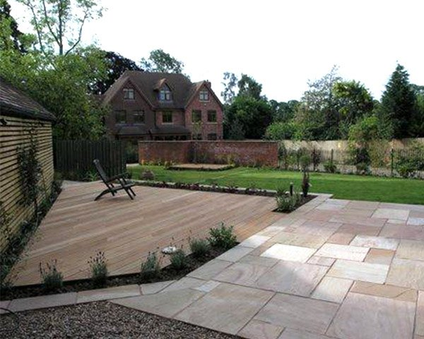 Mint Paving Stone patio in back garden with wooden deck