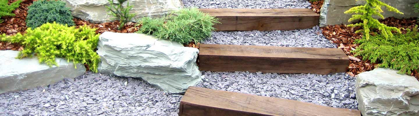 Purple slate chipping and wooden sleepers in garden design