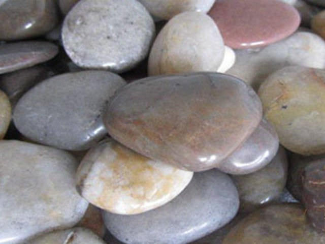 Grey and pink polished cobble stones
