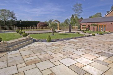 Sandstone paving used in garden with stone chippings and natural stone steps